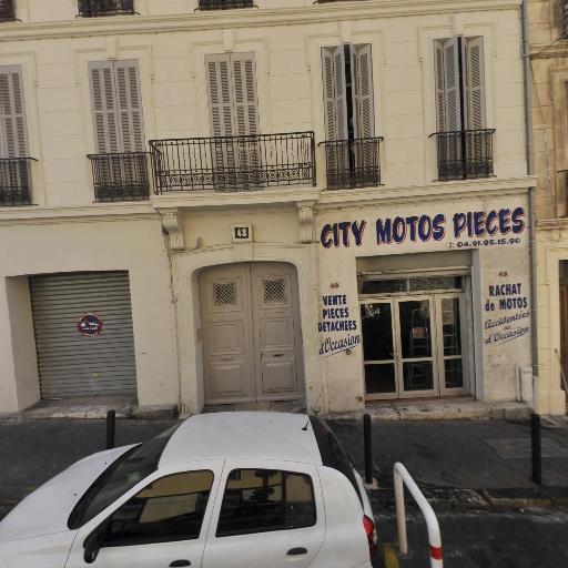 City Motos Pièces - Vente et réparation de motos et scooters - Marseille