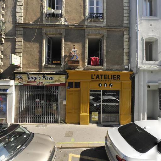 L'Atelier - Réparation et entretien d'instruments de musique - Nantes